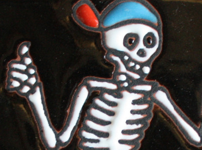 Gone Surfing. Day-Of-The-Dead Clay Tile Close-Up